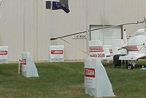 OTW Safety RMB48X40 Plastic Barricades with Optional Flags in Use at a Airplane Hangar
